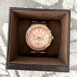 Rose Gold Michael Kors chronograph watch.